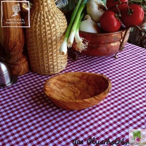 Small olive wood bowl in oval shape
