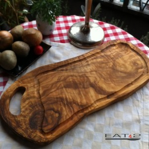 Cutting board olive wood, natural shaped and with a juice groove