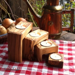 Set of 4 modern candle holders out of olive wood